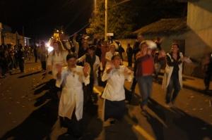 Margarita and her sister lead the volunteers in their dance