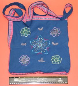 Cristina embroiders lovely shoulder bags