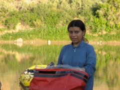 Cristina packs her drybag on the Green River