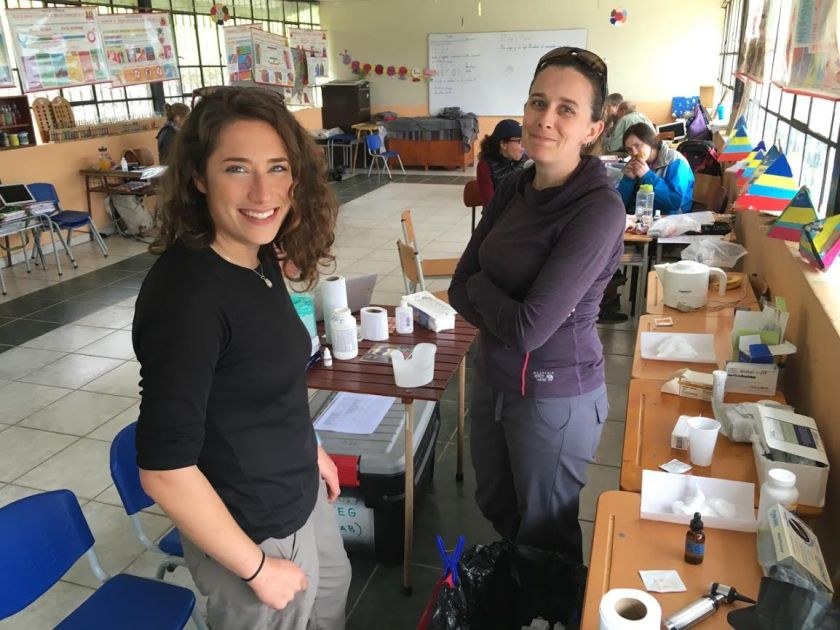 Kiera (right) working in the lab during the Health Care Volunteer Vacation