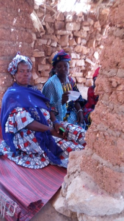 Madame Yalcouyé Mariétou Telly, right, reads a telephone number, which she wrote on a piece of paper, to the other students at the centre of Kédou.