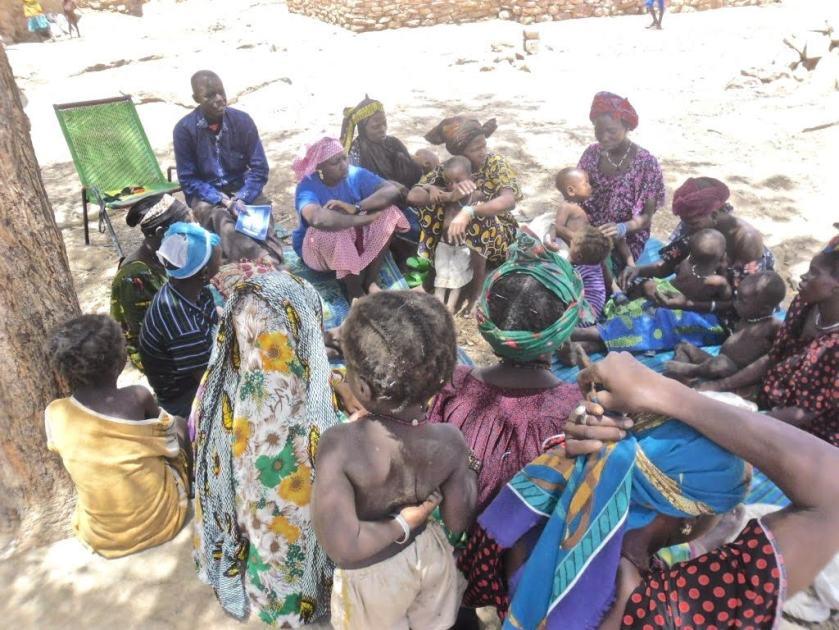 women in a Savings for Change group meet